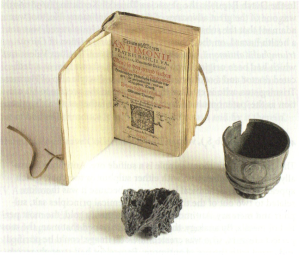 Antimony ore, antimony cup and Basilius Valentinus, Triump-Wagen Antimonii, Leipzig 1604. C. van Heertum, Alchemy on the Amstel. On Hermetic Medicine. Amsterdam: In de Pelikaan, 2012.